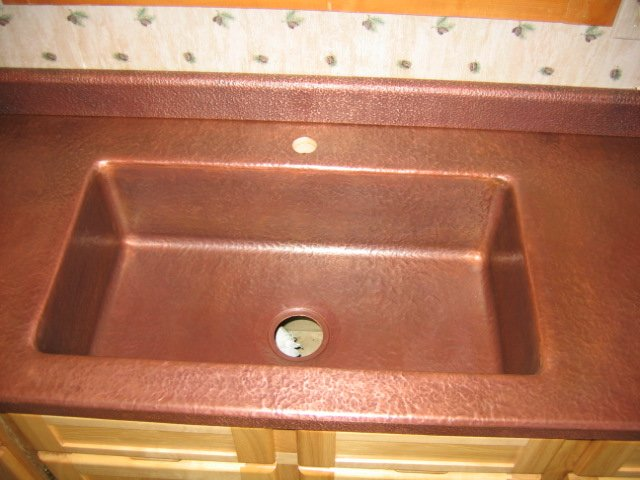 Custom Copper Kitchen Sink Integrated Into Countertop