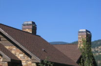 Rustic Copper Chimney Caps aged one year in Montana